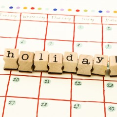 closeup holiday wording stack on calendar, reminder vacation concept and idea