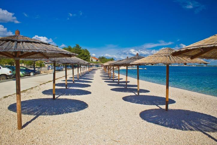 Island of Vir beach umbrellas, Dalmatia, croatia